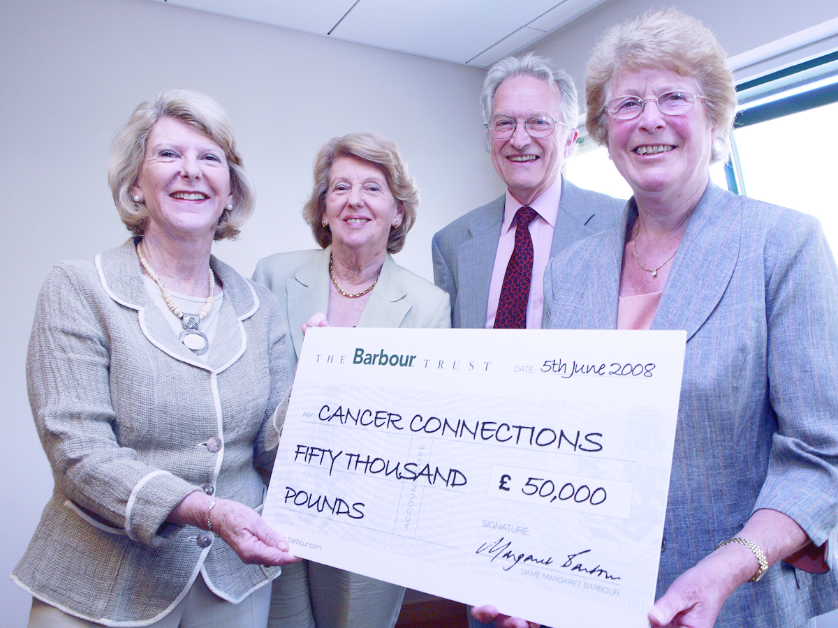 Dame Margaret Barbour presents a cheque to Cancer Connections, a South Tyneside charity in the North East of England dedicated to serving individuals and families, suffering from cancer.