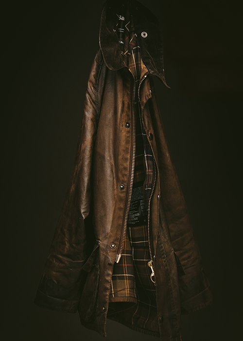 Barbour waxed jacket hanging to dry