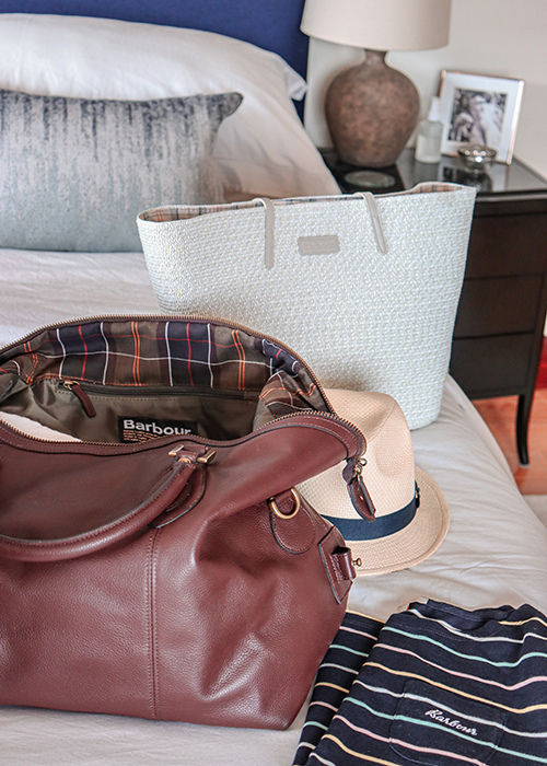 Sarah-Jane packs the SS21 Womens Summer Shop collection in her Leather Explorer bag