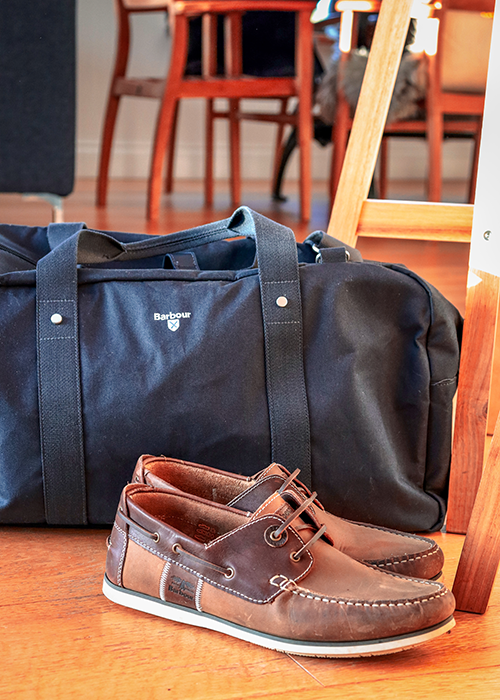 Barbour Cascade holdall with the Barbour Capstan boat shoes