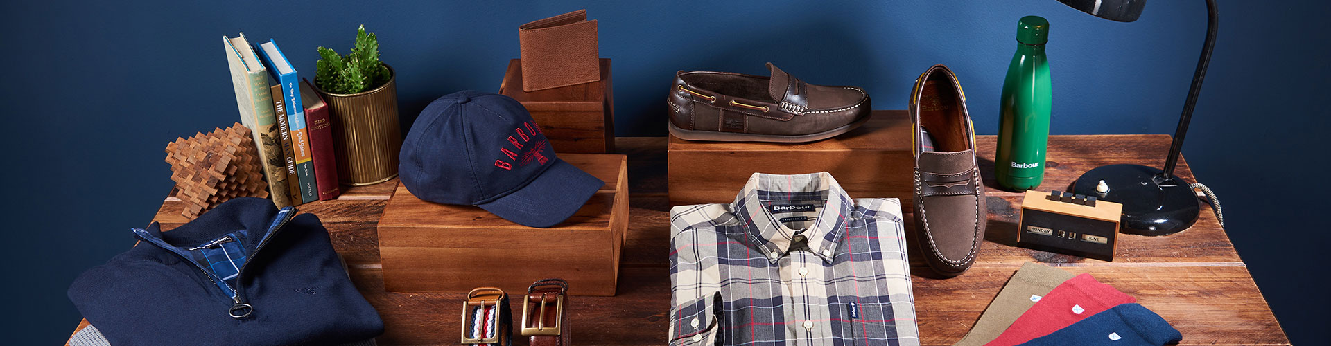 Flat lay of Father's Day office themed items and Barbour gift ideas.